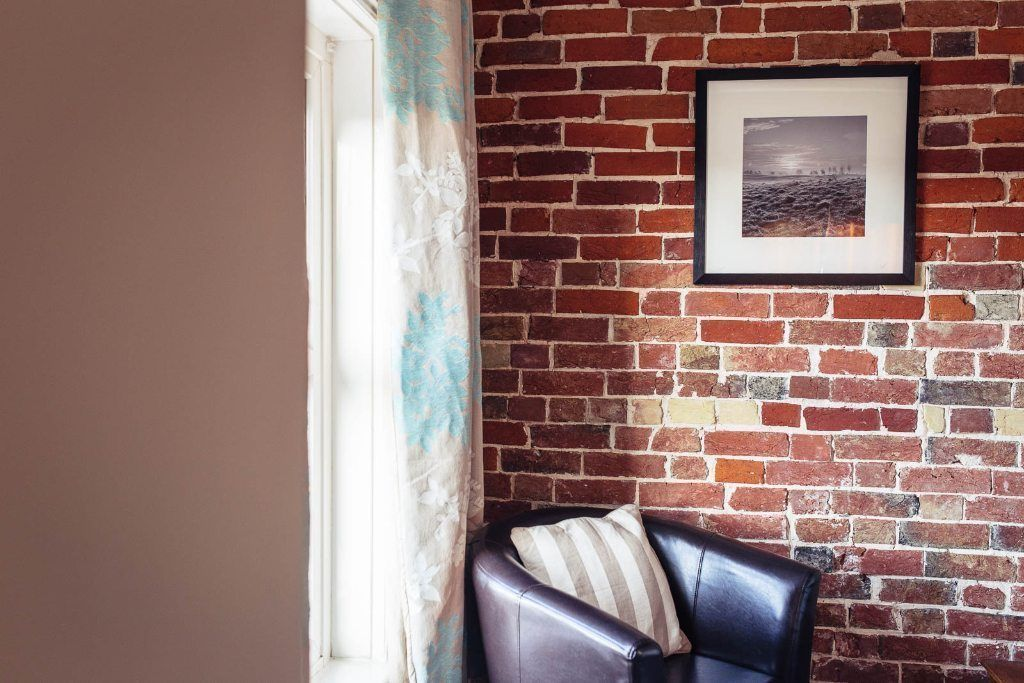 beautiful exposed 1850s brick wall